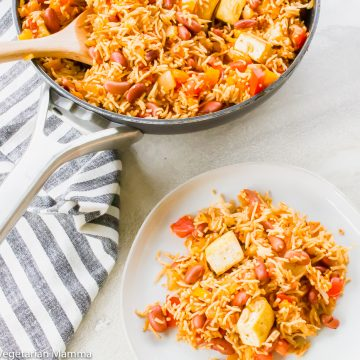 Tofu with spanish rice and bean shown in a skillet and on a white plate