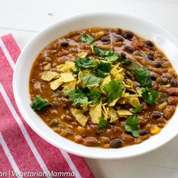 Instant Pot Taco Soup in white bowl followed by red and white striped cloth