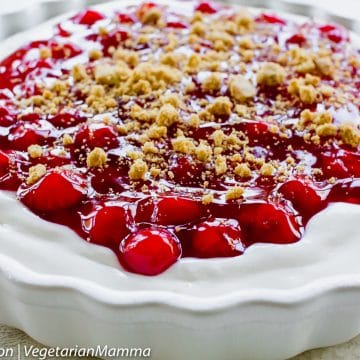 Close up view of Cherry Cheesecake in white pan