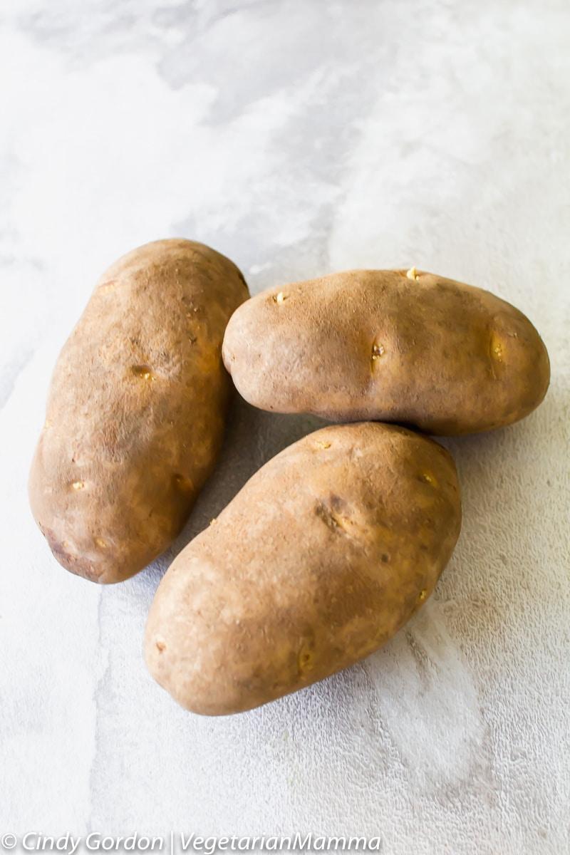 three whole potatoes