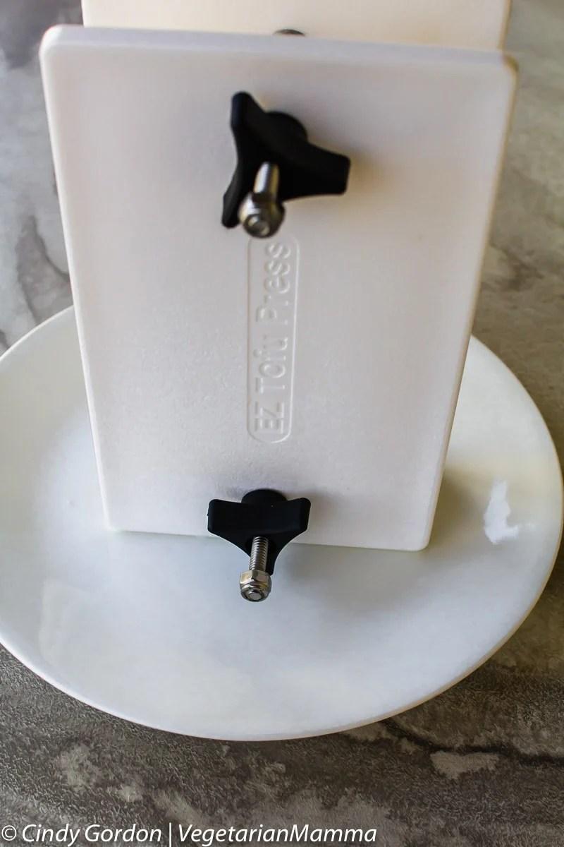 ez tofu press on a plate.