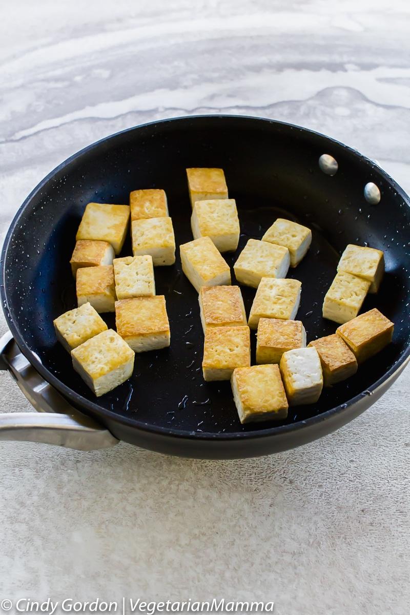 Honey Sriracha Tofu fried in a pan