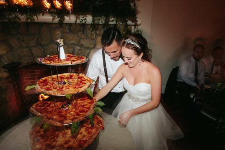 2 Pizza Lovers Tie The Knot And Serve A Huge Pizza Instead Of A        Tony and I love pizza and aren t huge fans of cake  so we surprised our  guests with pizza cake     the bride told Wedding Chicks     It was saucy and  delicious