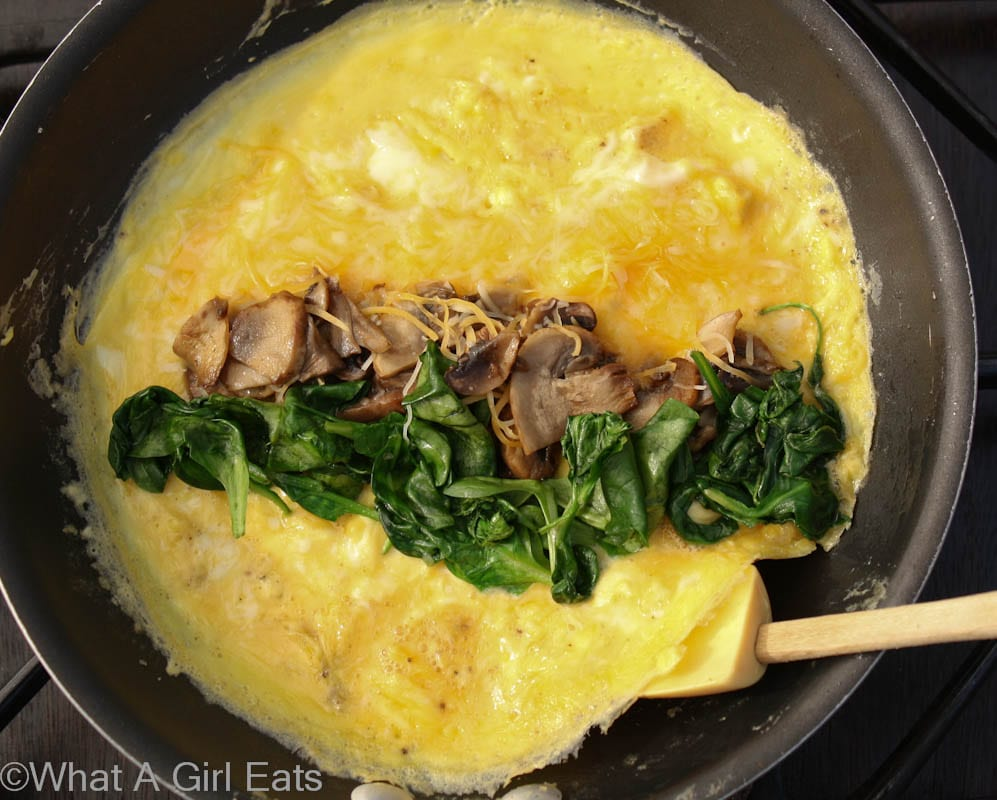 Creating the perfect spinach mushroom and cheese French omelet | @whatagirleats.com