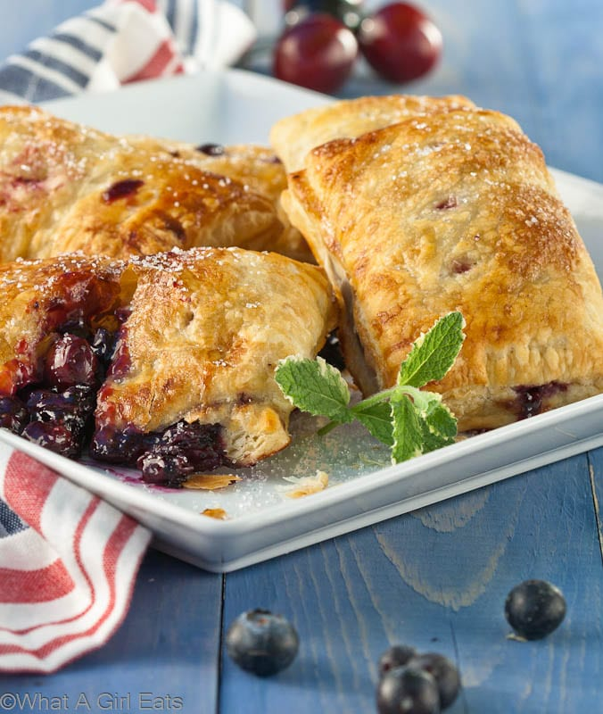 Triple Berry and Cherry Hand Pies - Perfectly portable dessert on the go! | What a Girl Eats