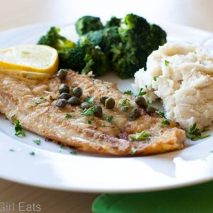 Pan-Fried Dover Sole with Capers and Lemon is a fast and easy-to-make fish dish for a busy weeknight. This meal comes together in less than 30 minutes!   What a Girl Eats