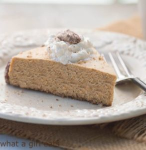 Gluten free Pumpkin Spice Cheesecake with Sugar Pecans and Bourbon-Maple Whipped Cream