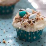 Coconut cupcakes are a beautiful and delicious Easter dessert, and these coconut cupcakes are adorned with toasted coconut bird's nests, making them perfect for any spring brunch.   WhatAGirlEats.com