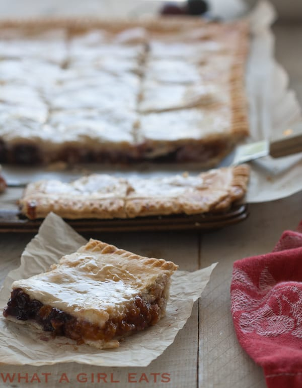 Apricot-cherry slab pie is a portable dessert, with a buttery, flaky crust and fresh spring fruit filling. It's perfect picnic food. - Recipe on WhatAGirlEats.com