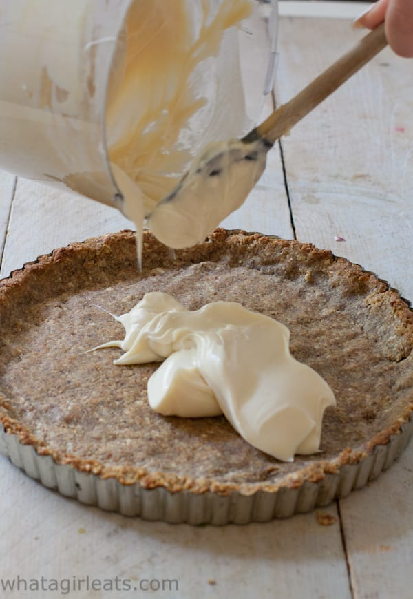 Pouring lemon curd mixture into tart shell