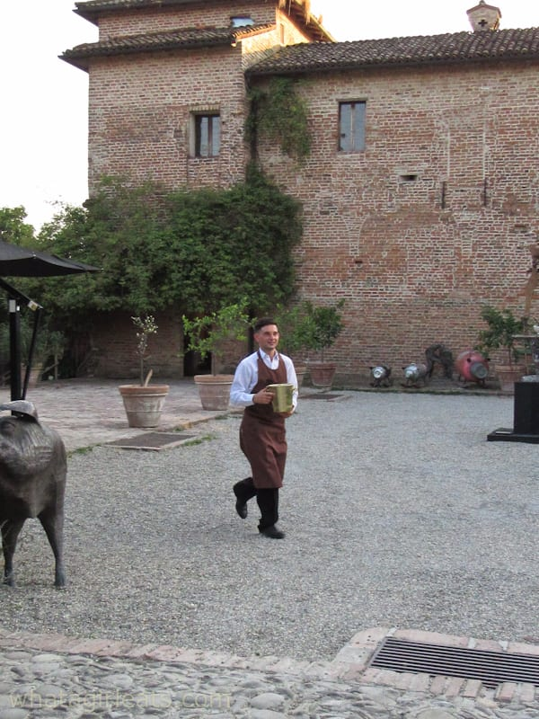 courtyard and waiter at Antica Corte Pallavicina: A Relais In Northern Italy
