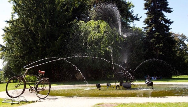 Reclaimed Bike Used As A Fountain In A Public Art