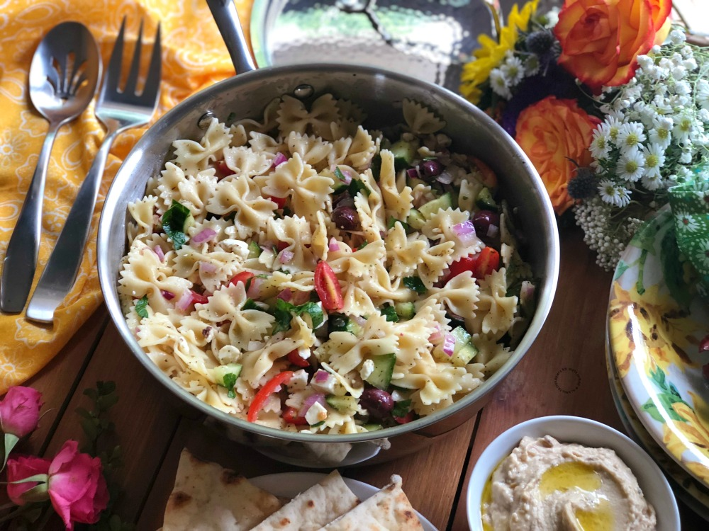 Serving the farfalle pasta salad family style