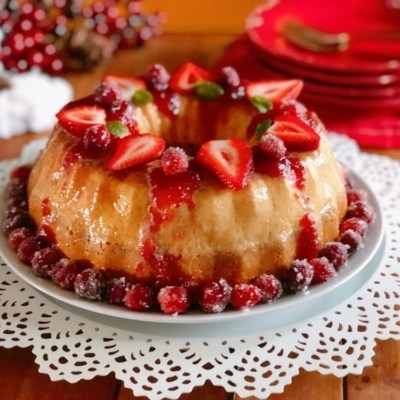 Vanilla Flan Cake with Berry Sauce