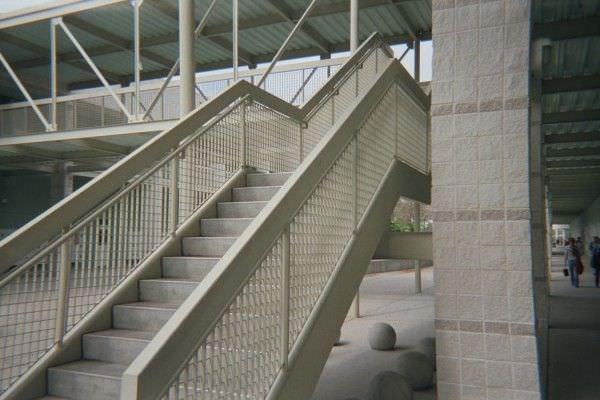 Railings Ametco Manufacturing | Wire Mesh Stair Railing | Exterior Perforated Metal | Galvanized Mesh | Staircase | Modern | Mesh Balustrade