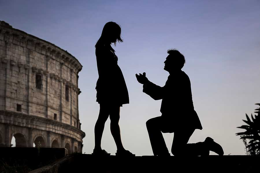 Surprise Wedding Proposal Photographer in Rome Italy Surprise Wedding Proposal Photographer in Rome Italy  Image taken at the  roman Coliseum at sunset