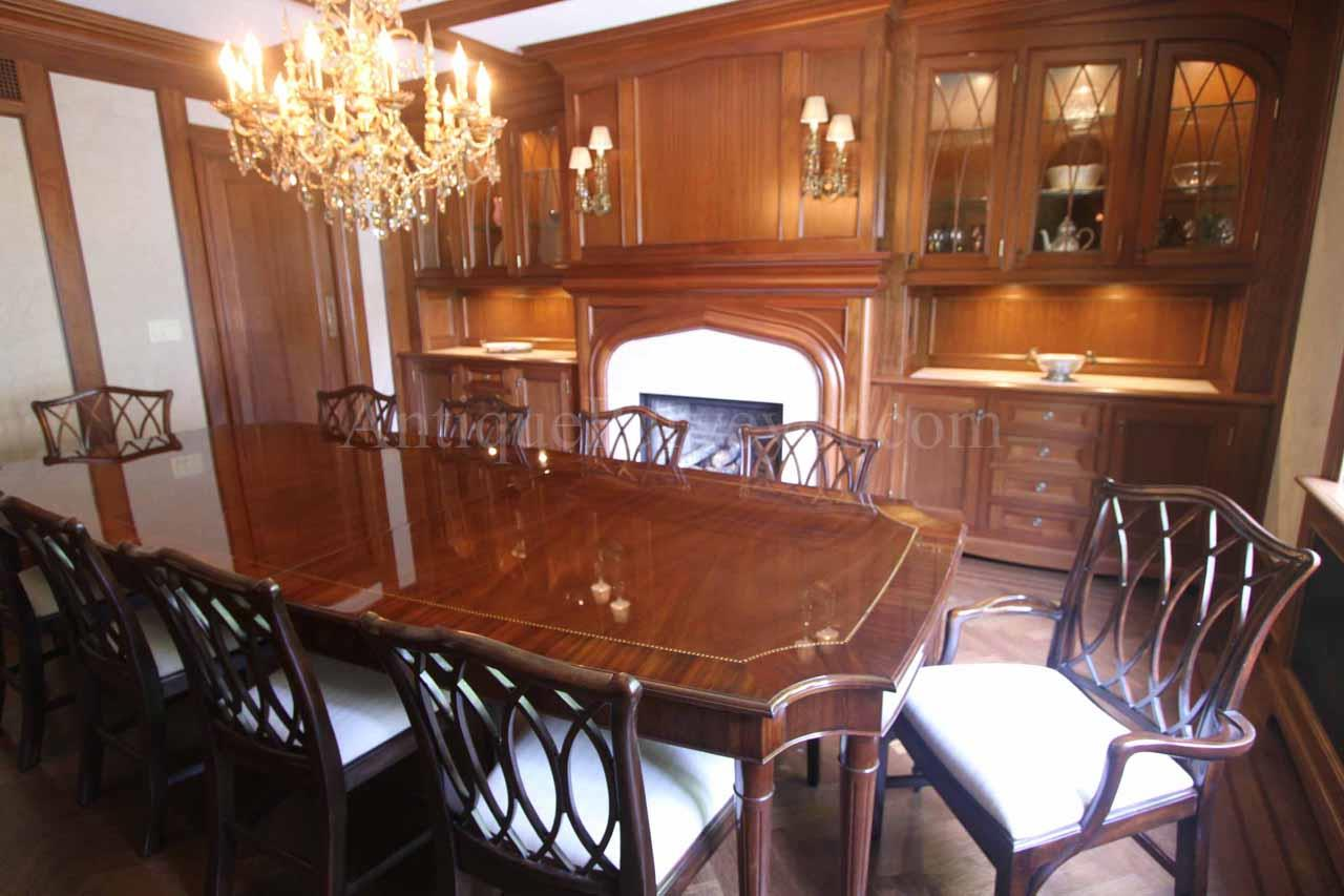 french style 8 leg table with chippendale dining chairs