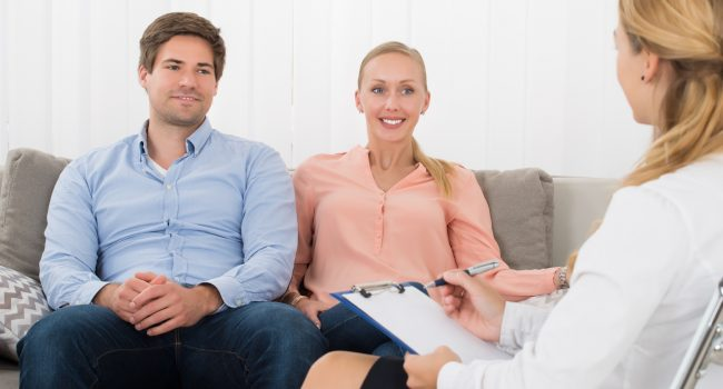 Young Couple Consulting With Psychologist