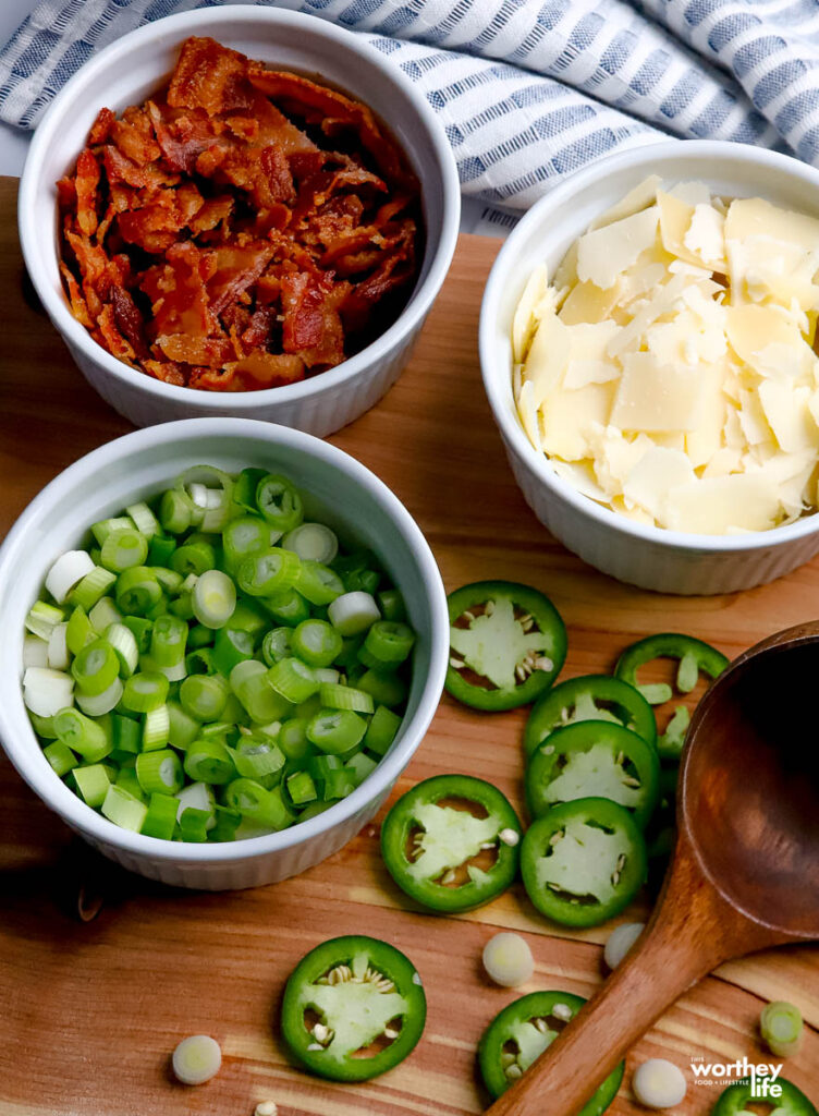 white bowls with onions, bacon and fresh cheese