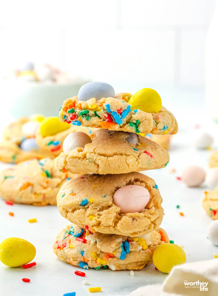 mini egg cookies stacked on top of each other
