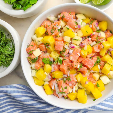 salmon ceviche in a white serving bowl
