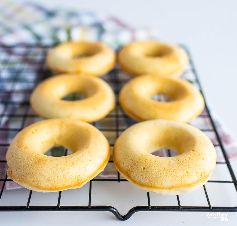 freshly baked lemon donuts on a cooling rack
