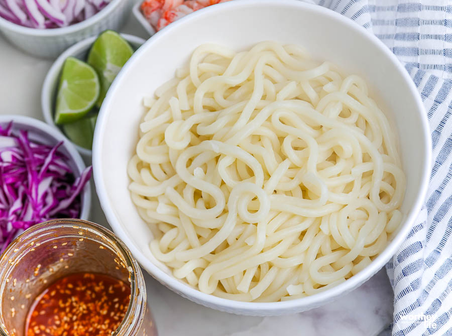 thick noodles in a white bowl
