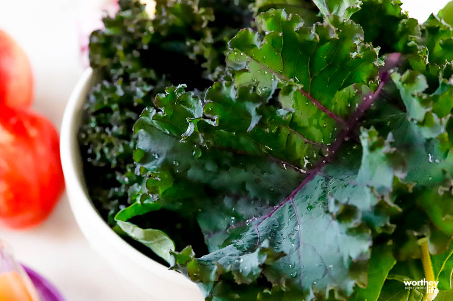 a white bowl filled with fresh garden kale