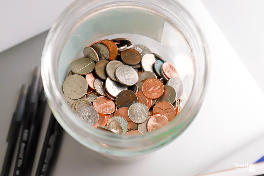 loose coins in a glass jar