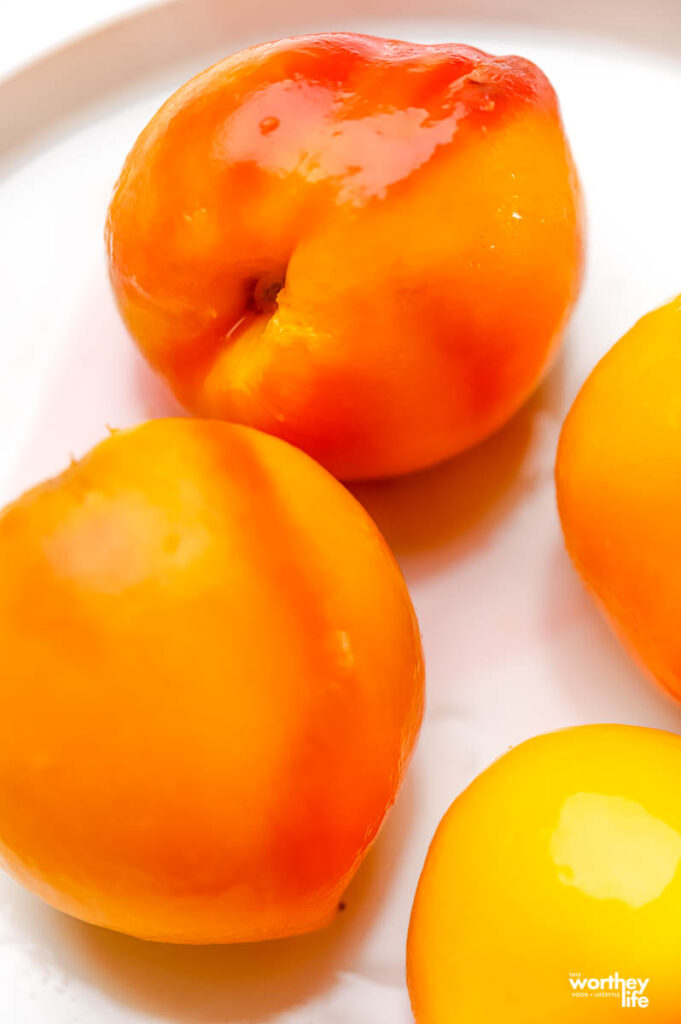 how to cook fresh sweet peaches on white plate