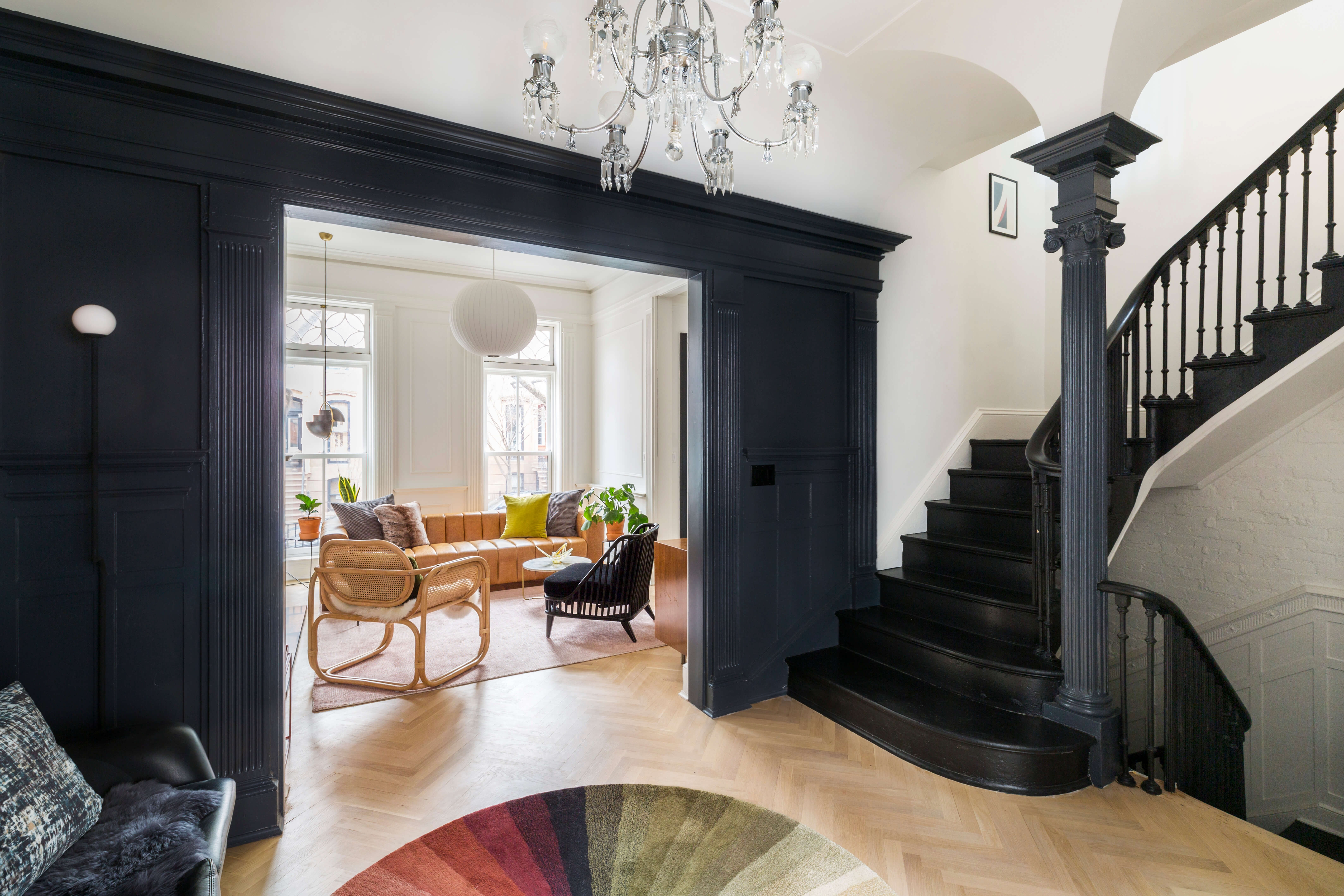 The Insider Central Stair Bold Black Paint Distinguish Renovated | Stairs Wall Paint Design | Luxury Staircase Wall | Wallpaper | Wall Colour | Beautiful | Wall Painting
