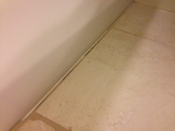 Repair Caulk  Grout  and Drywall in a Weekend   Checking In With Chelsea tan bathroom tub missing grout along bottom of bathtub