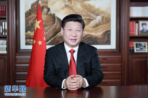 Xi highlights poverty reduction  int l role in New Year speech     Xi highlights poverty reduction  int l role in New Year speech