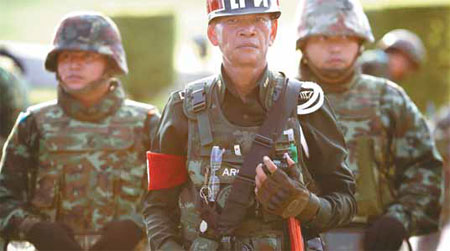A Thai Military Officer Leads His Unit In Blocking The