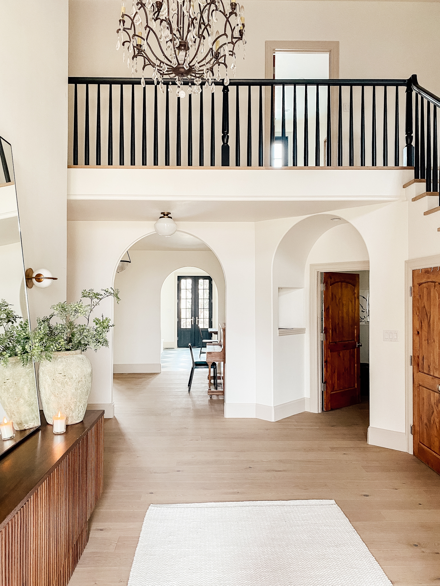 How We Completely Updated Our Stair Railings By Only Swapping Out   Stair Posts And Spindles   Landing   Natural Hardwood   Rectangular   Traditional   Wood