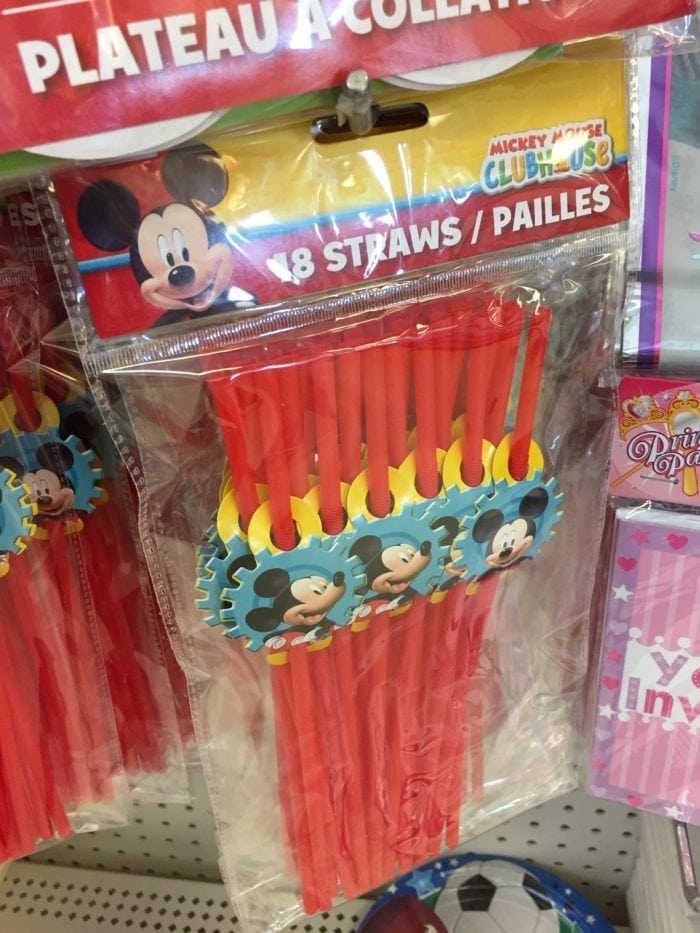 A group of Mickey mouse straws on display
