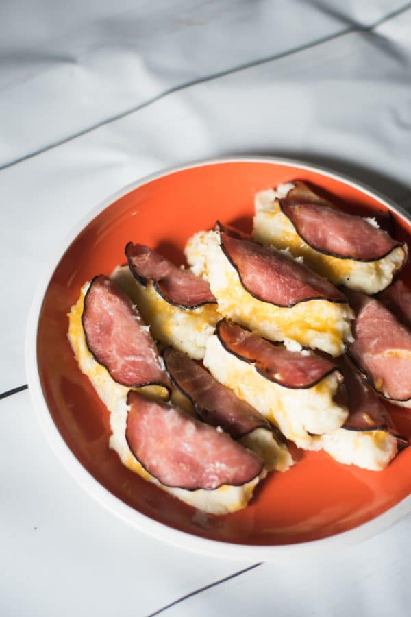 A plate of food on a table, with Ham and Potato