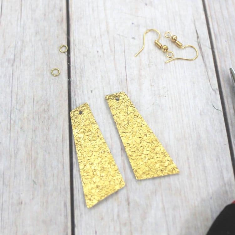 A wooden cutting board, with Earring