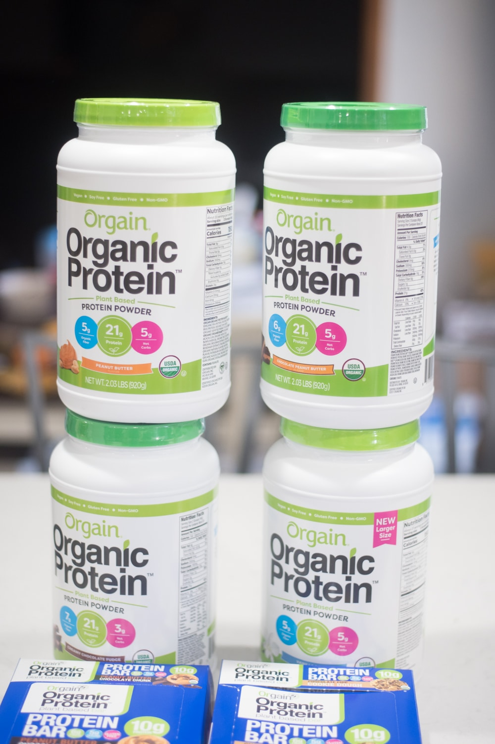 A close up of a protein bottle
