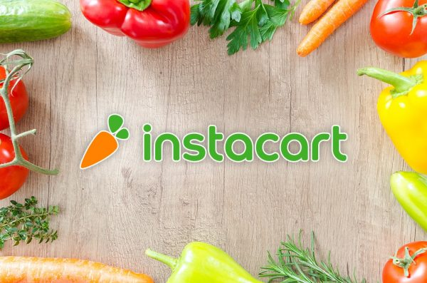Fresh fruit and vegetables on a cutting board, Instacart logo