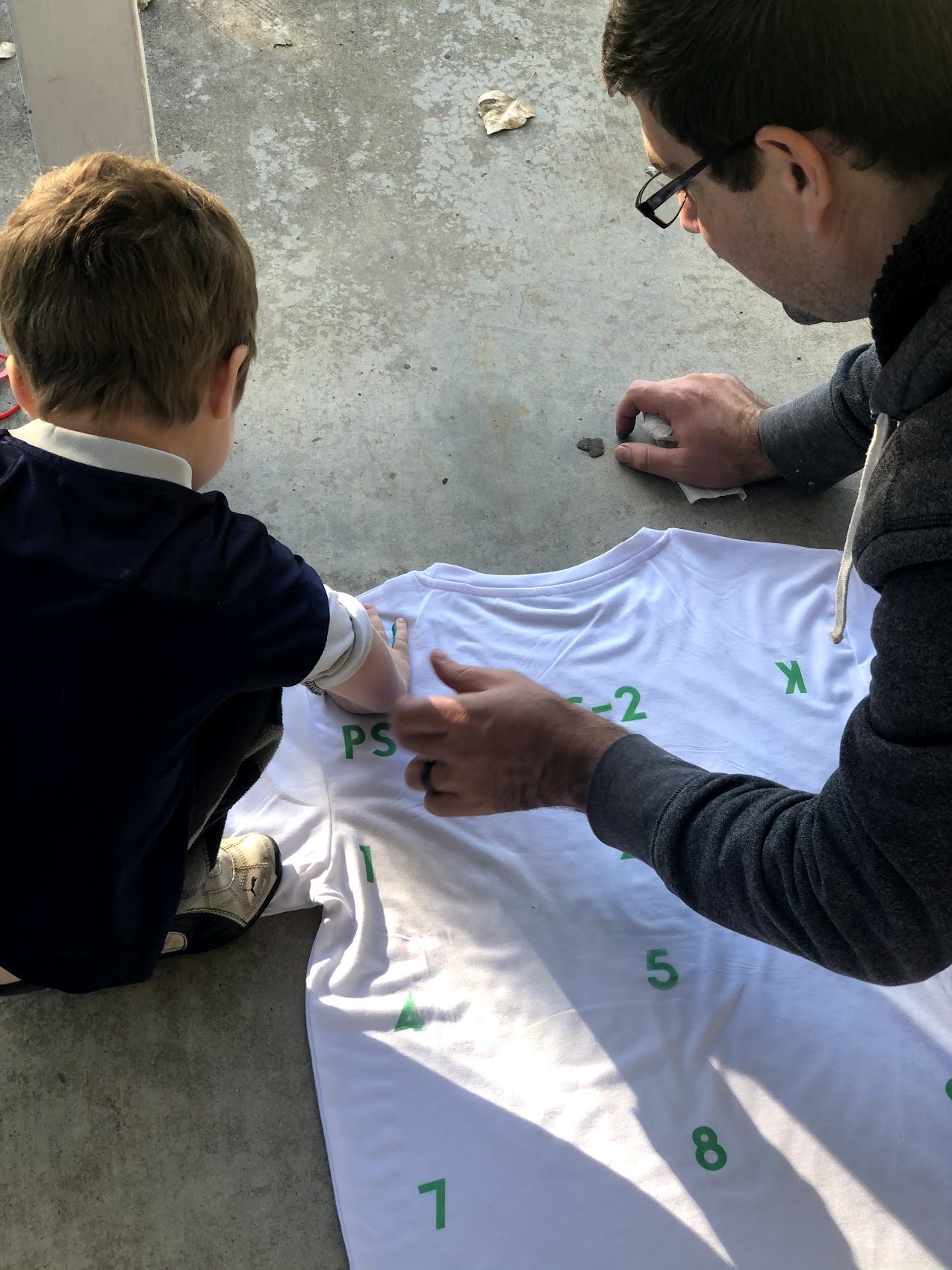 boy and father with shirt