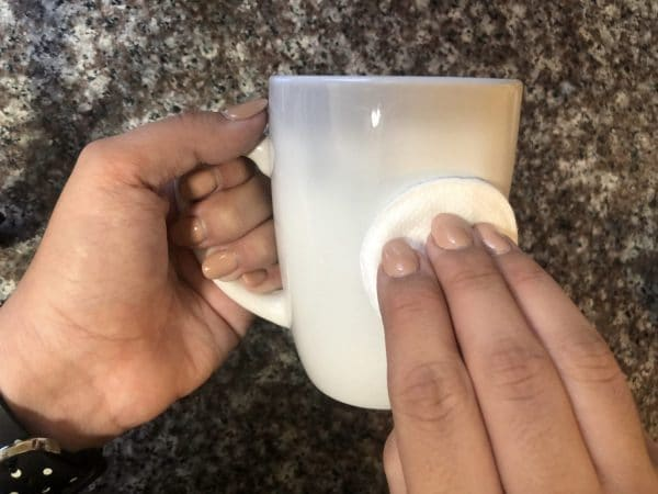 cleaning mug with rubbing alcohol