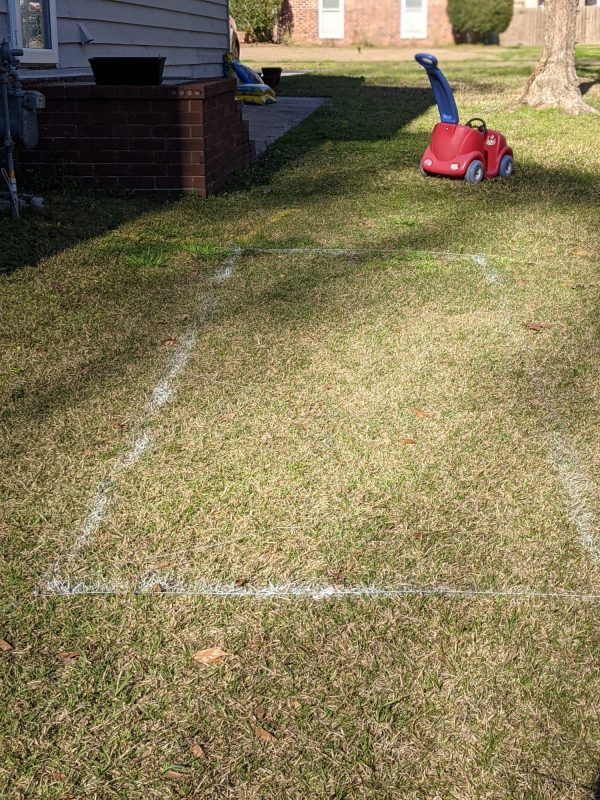 We laid out the garden plot with paint, and with twine to ensure a straight, even line.