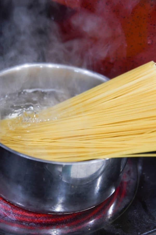 boiling noodles in a pot
