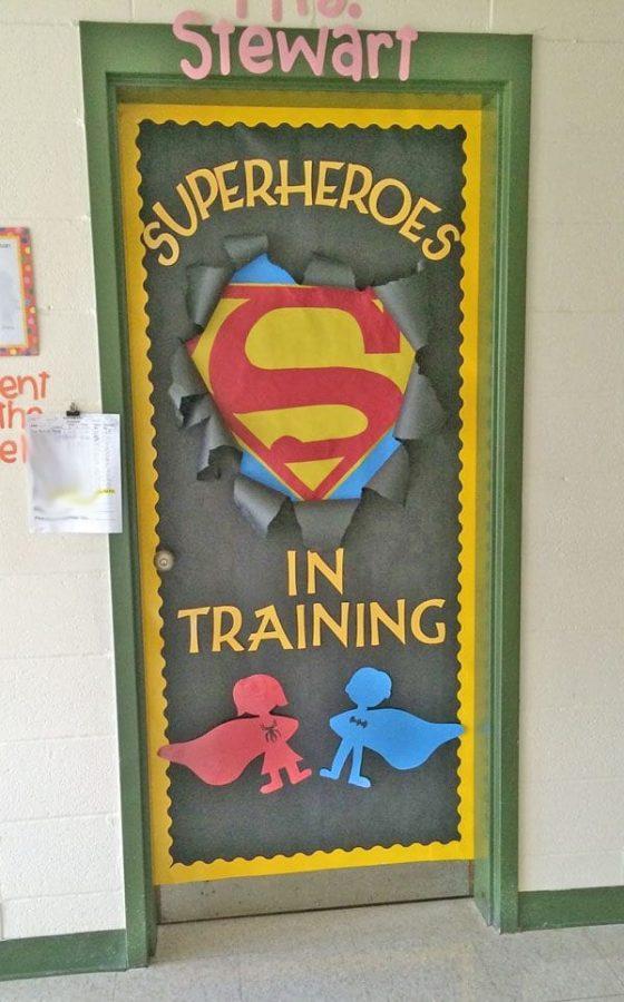 superheroes in training door