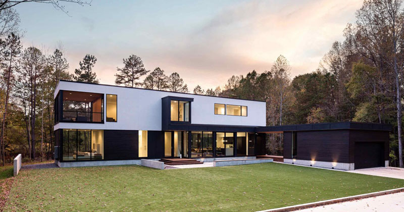 This New Contemporary House Surrounded By Trees Overlooks