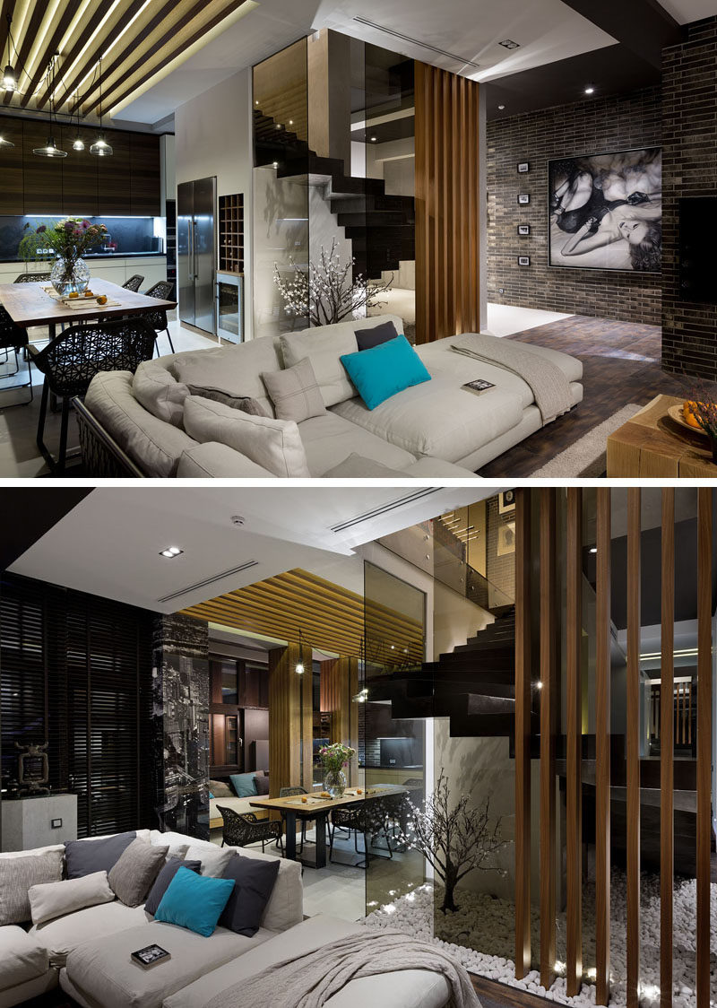 Materials Like Dark Brick Wood And Glass Are Used In The