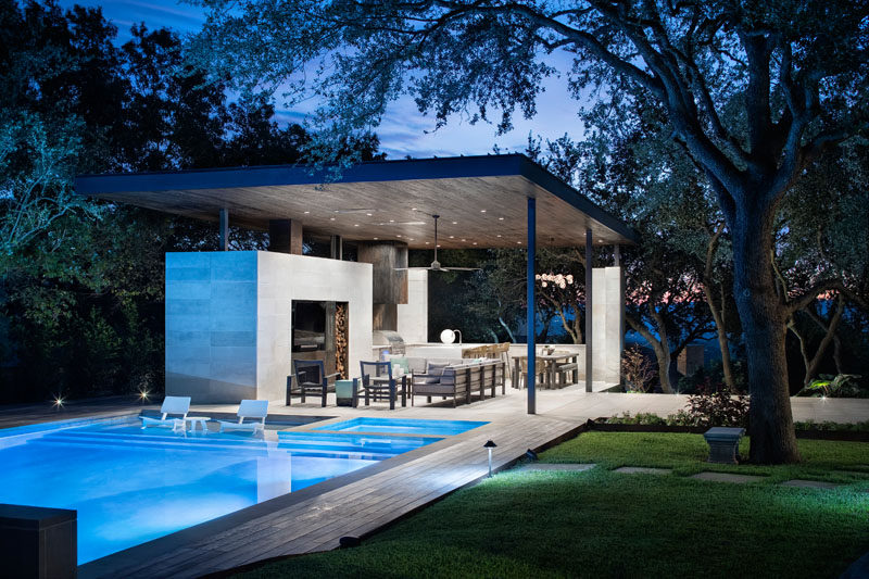 This Poolside Living Room And Kitchen Sits Under A Large