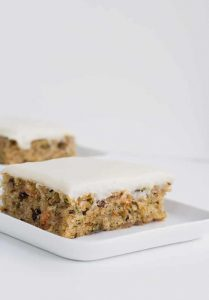 homemade zucchini bars topped with cream cheese frosting