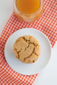 overhead photo of one apple cider snap cookie on white plate